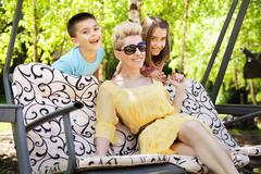 happy family relaxing during sunny vacations - stock photo