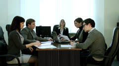 Discussion of current affairs in the office - stock footage
