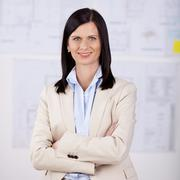Businesswoman with folded arms Stock Photos