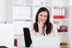 Stylish businesswoman in the office Stock Photos