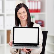 smiling businesswoman displaying her laptop - stock photo