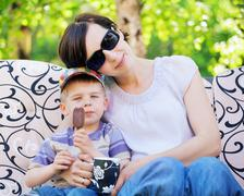 Pleased mother relaxing with her son Stock Photos