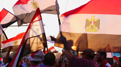 The sun shines through protestor's flags in Cairo, Egypt. - stock footage