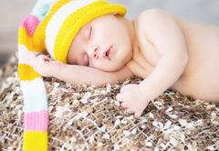 Picture of sleeping baby with woollen cap Stock Photos