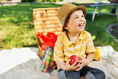 smiling chlid holding juicy apple - stock photo