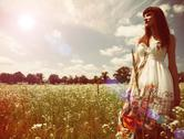 Stock Photo of beauty young woman walking around the summer meadow