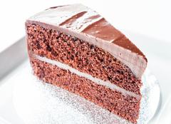 piece of chocolate chiffon cake on white plate - stock photo