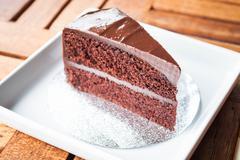 chocolate chiffon cake serving on white plate - stock photo