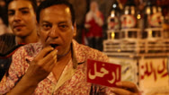 Stock Video Footage of A protestor blows a whistle at a rally in Cairo, Egypt.