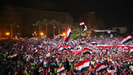 Stock Video Footage of Protestors chant at a nighttime rally in Tahrir Square in Cairo, Egypt.