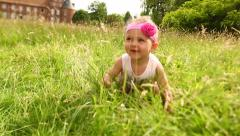 Little female baby in park crawling shot with tilt shift lens Stock Footage