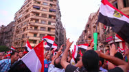 Stock Video Footage of Protestors chant and wave flags in Cairo, Egypt.