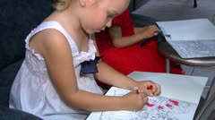 Little girls draw Stock Footage