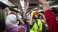Stock Video Footage of Protestors chant while aboard a metro in Cairo, Egypt.