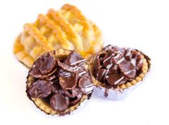 Set of tasty tartlets with chocolate Stock Photos