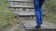 Closeup retro wooden stone stair nature park woman climb upstair Stock Footage