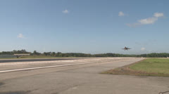 F-18 Hornet aircraft  pilots conduct field carrier landing practice Stock Footage