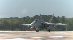 F-18 Hornet aircraft  pilots conduct field carrier landing practice Stock Footage