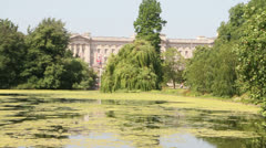 Buckingham Palace as viewed from St James Park Stock Footage