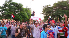 Protestors march and chant in Cairo, Egypt Stock Footage