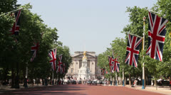 Buckingham Palace, London long shot down The Mall - stock footage