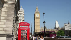 Red telephone box and Houses of Parliament, Westminster, London, England - stock footage