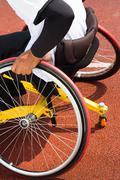 Wheelchair sportsmen at race track Stock Photos