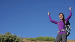 Happy success winner hiker cheering and hiking Stock Footage