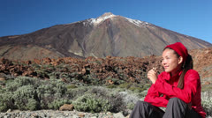 Hiking woman resting eating muesli bar on Tenerife Stock Footage