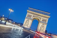 Arc de triomphe at night. Stock Photos