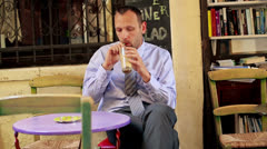 Young businessman drinking ice coffee in cafe HD Stock Footage