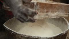 Sifting flour Congo - stock footage