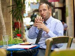 Young happy businessman drinking ice coffee in cafe NTSC Stock Footage