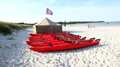Rent a kayak at the beach at Bornholm, Denmark Stock Footage
