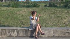 Beautiful young woman. Relaxing in the park Stock Footage