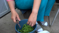 Person cutting green beans Stock Footage