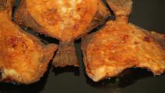 Flounder fish frying on pan Stock Footage