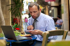 Businessman with smartphone and laptop in cafe NTSC Stock Footage