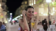 Beautiful woman drinking cocktail in outdoor bar, steadicam shot HD Stock Footage