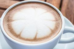 milk microfoam topped on hot cafe mocha cup - stock photo