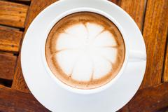 beautiful cup of hot cafe mocha on wooden table - stock photo