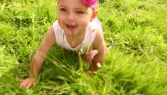 Baby girl having fun discovering and crawling in nature Stock Footage