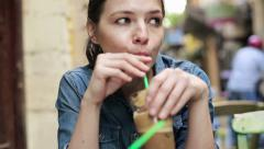 Sad pretty woman drinking ice coffee in cafe HD Stock Footage