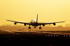 Airplane sunrise landing - stock photo