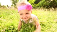 Slow motion video of baby crawling in park - stock footage