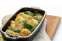 Gratin of cauliflower, broccoli and cheese Stock Photos