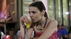 Sad woman drinking alcohol in outdoor bar, steadicam shot HD Stock Footage