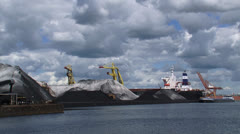 Transshipment of coal in Dutch port + moored ship - stock footage