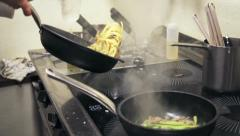 Chef preparing pasta on stew pan Stock Footage