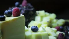 Sweet appetizer, fruits and cheese - stock footage